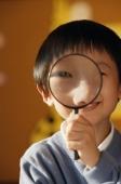 Schoolboy with magnifying glass - Alex Mares-Manton