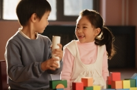 Young children playing with building blocks - Alex Mares-Manton