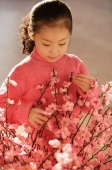 Little girl with cherry blossom branches - Alex Mares-Manton