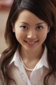 Young woman smiling at camera - Alex Mares-Manton