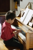Little boy playing piano - Alex Mares-Manton