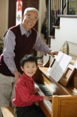 Boy playing piano for grandfather - Alex Mares-Manton