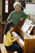 Girl playing piano for grandmother - Alex Mares-Manton