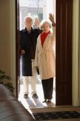 Elderly couple in door frame waving at camera - Alex Mares-Manton