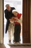 Boy greeting grandparents at door - Alex Mares-Manton