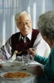 Elderly couple at dinner table - Alex Mares-Manton