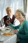 Elderly couple at dinner table - Alex Mares-Manton