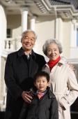 Elderly couple with grandson smiling at camera - Alex Mares-Manton