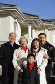 Family smiling at camera - Alex Mares-Manton