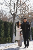 Young couple walking in park - Alex Mares-Manton