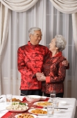 Elderly couple in traditional clothing looking at each other - Alex Mares-Manton