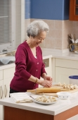 Elderly woman baking in the kitchen - Alex Mares-Manton