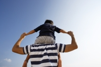 Father piggybacking son - Yukmin