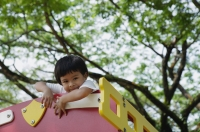 Young boy playing at the park, looking at camera - Yukmin