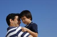 Father carrying son - Yukmin