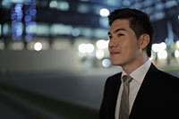 Profile of young man wearing a business suit at night. - Alex Mares-Manton