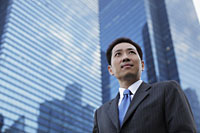 Mature man in a suit standing in front of a building - Alex Mares-Manton