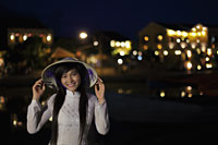 Young woman wearing traditional Vietnamese outfit at night, Vietnam - Alex Mares-Manton