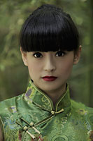 Portrait of young woman wearing traditional Chinese dress. - Alex Mares-Manton