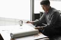 Mature man working in an office - Alex Mares-Manton