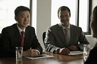Business men having a meeting - Alex Mares-Manton