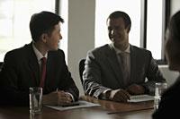 Business men talking during a meeting - Alex Mares-Manton