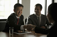 Business people shaking hands during a meeting - Alex Mares-Manton