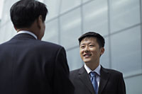 Businessmen talking together outside - Alex Mares-Manton