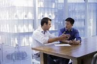 Young men having a meeting in modern office - Alex Mares-Manton
