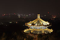 Night view of Beijing city scape at night with Pagoda in foreground - Alex Mares-Manton