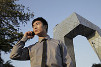 Young man speaking on phone in front of the CCTV Building - Alex Mares-Manton