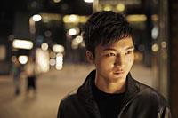 Head shot of a young man at night - Alex Mares-Manton