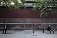 Old people sitting on benches at a park, Beijing, China - Alex Mares-Manton