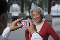 Older woman having her photo taken. - Alex Mares-Manton