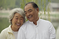 Head shot of older couple smiling outdoors - Alex Mares-Manton