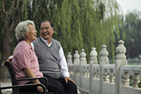 Older couple laughing at each other in a park - Alex Mares-Manton