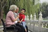 Grandparents playing with their grandson in a park - Alex Mares-Manton