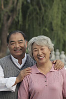 Older couple smiling together outdoors - Alex Mares-Manton