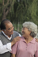 Older couple smiling at each other - Alex Mares-Manton