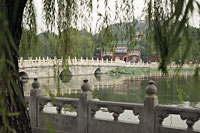Scenic view of stone bridge and lake. Beihai Park, China - Alex Mares-Manton