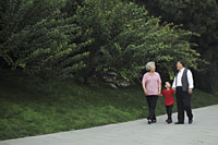 Older couple walking with grandson in the park - Alex Mares-Manton