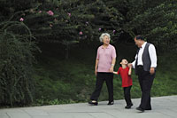 Grandmother, grandfather and grandson walking in the park - Alex Mares-Manton