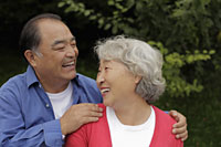 Older couple laughing together - Alex Mares-Manton