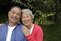 Older couple smiling togther outdoors - Alex Mares-Manton