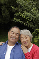 Head shot of older couple hugging outdoors - Alex Mares-Manton