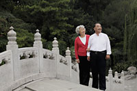 Older couple standing on a bridge looking at view - Alex Mares-Manton