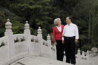 Older couple standing on bridge looking at each other - Alex Mares-Manton