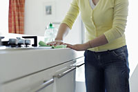 Cropped shot of woman wiping kitchen counter - Alex Mares-Manton