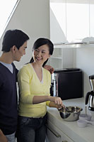 Couple making food together in the kitchen - Alex Mares-Manton