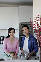 Couple cooking in kitchen together - Alex Mares-Manton